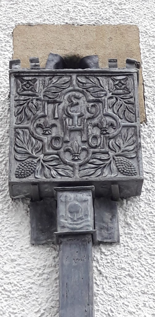 Drain hopper detail showing the motif of the Rowan tree, which is used in the family crest and throughout the building, in furniture, fabrics and stained glass.